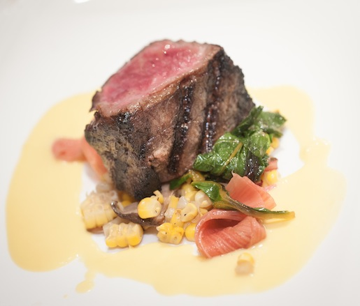 Wagyu Flatiron Steak with Maitake Mushrooms, Corn Pudding, Swiss Chard, and Pickled Rhubarb