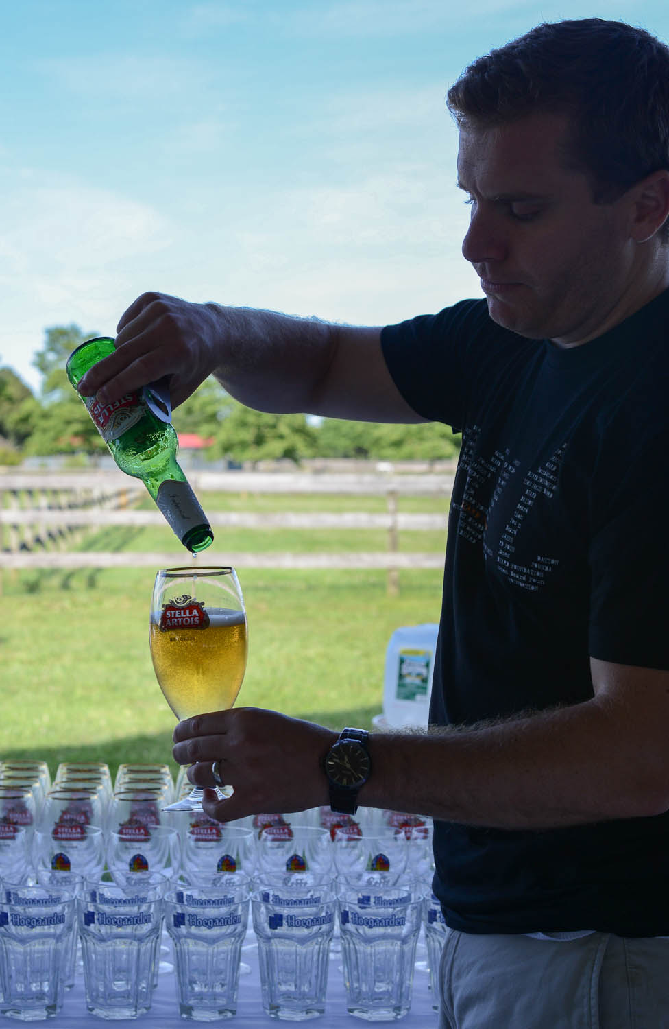 Stella Artois beer being poured into its signature chalice