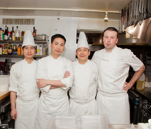 Chef Ho Chee Boon and chef Rory Macdonald with members of their team in the Beard House kitchen