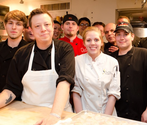 Chance Bear and Peyman Pourpezeshk with members of their team in the Beard House kitchen