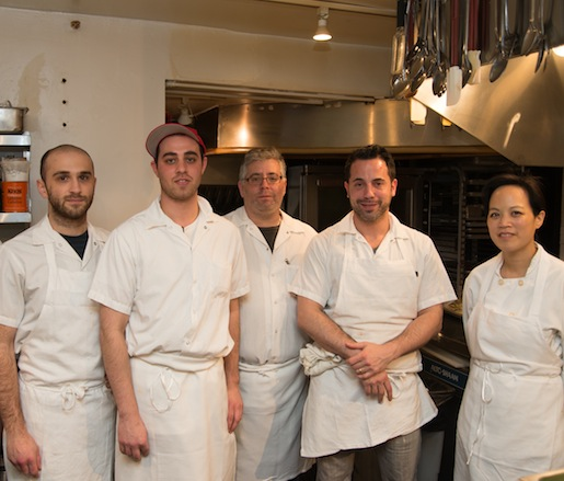 Chef Todd Mitgang with members of his team in the Beard House kitchen