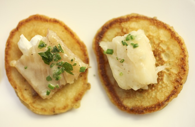 Smoked Trout on Potato–Chive Blini with Sweet Onion Sour Cream