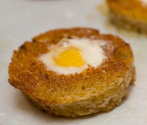 Quail egg in rustic toast for toad in the hole