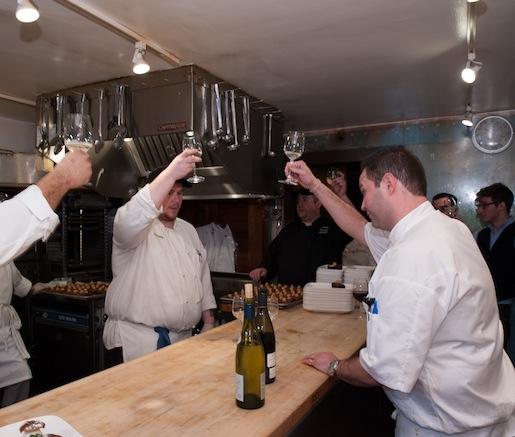 Chef Tason Tilmann toasts his team at the Beard House