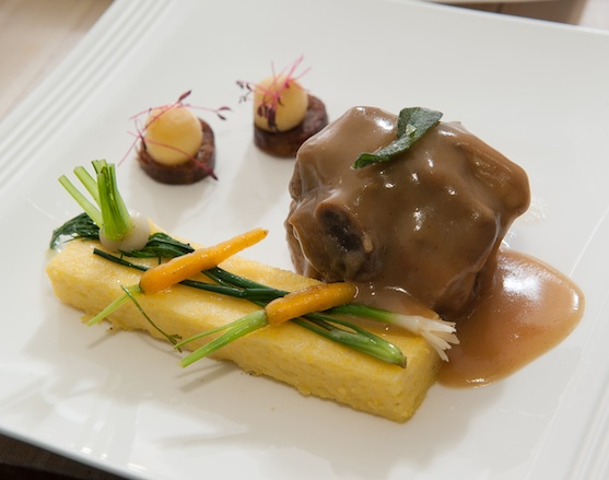 Cider and Sage–Braised Turkey Shank with Crispy Chorizo, Polenta Pavé, Foie Gras–Poached Apples, and Root Vegetables