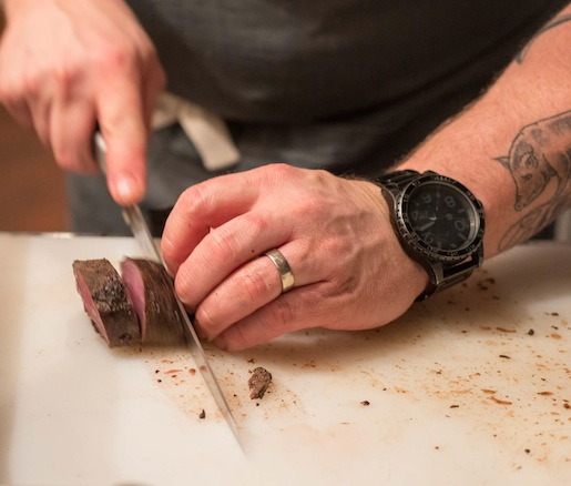 Chef Bryan Voltaggio slicing venison