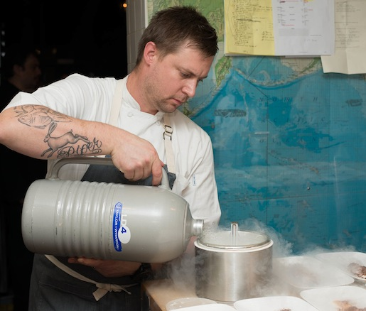 Chef Bryan Voltaggio preparing dessert in the Beard House kitchen