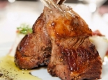 Rick Bayless's recipe for Grilled Rack of Lamb with Honey–Pasilla Glaze, adapted by the James Beard Foundation