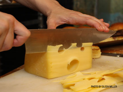 Slicing cheese at a Beard House dinner.
