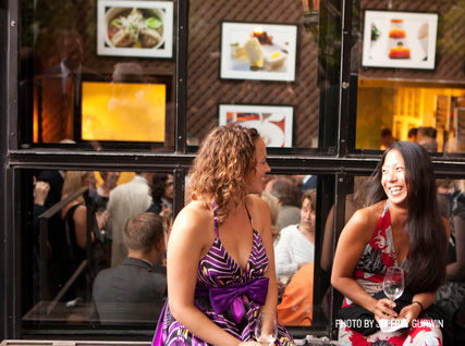 Guests enjoy the back patio at the Beard House.