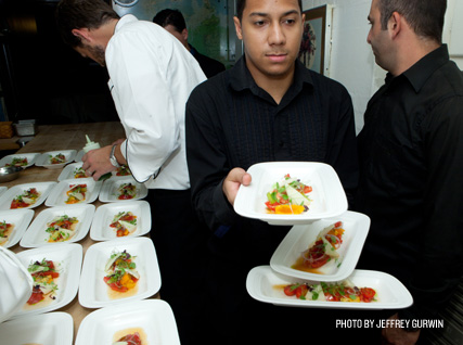 Serving a fresh tomato salad at a Beard House dinner.