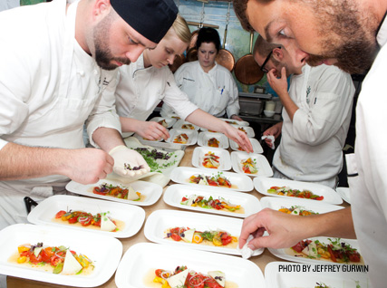 Busy plating dishes at a Beard House dinner.