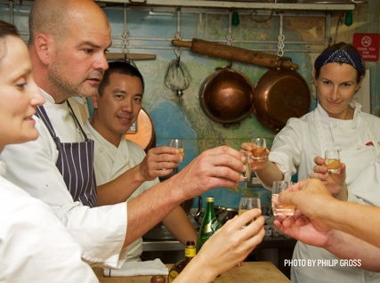 Christian Caiazzo of Osteria Stellina celebrates with a shot in the Beard House kitchen