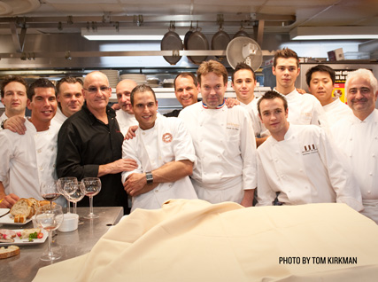 Chefs and volunteers from the French Culinary Institute pose for a photo
