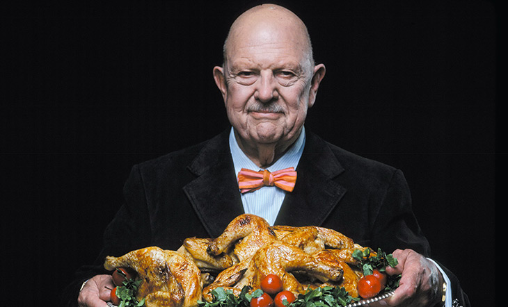 James Beard holding a tray of cooked chicken Photo by Dan Wynn