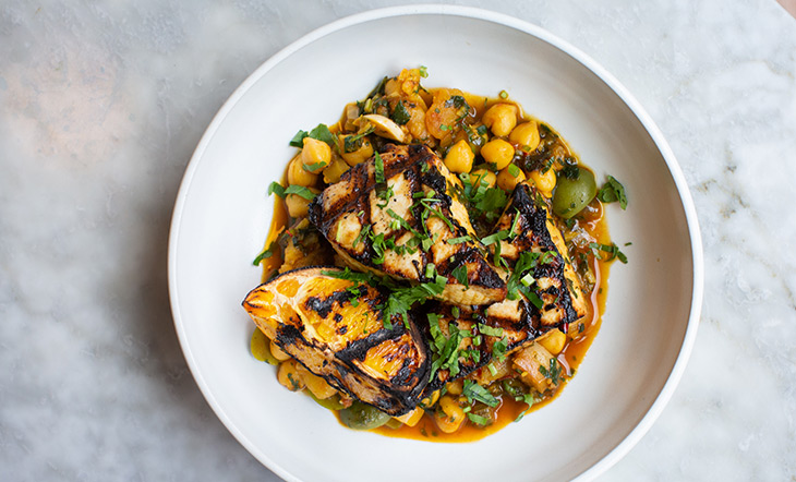 Swordfish with chickpeas and orange photo by Clay Williams