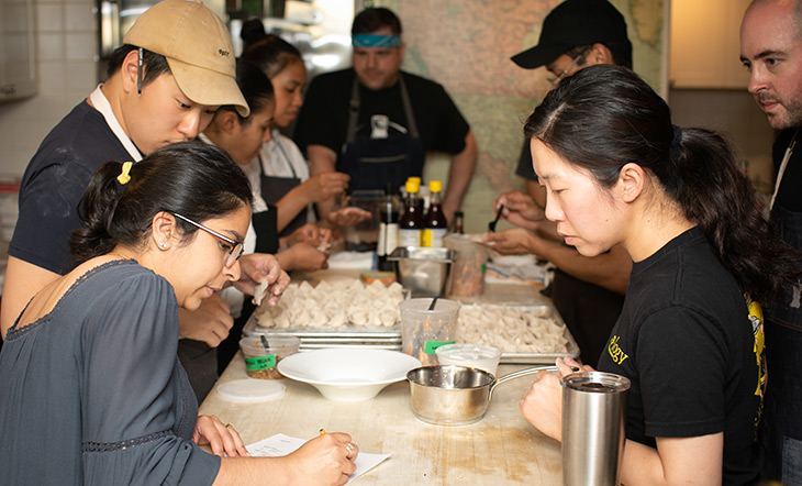Organizer Sabrina Medora and chefs in the Beard House kitchen photo Clay Williams