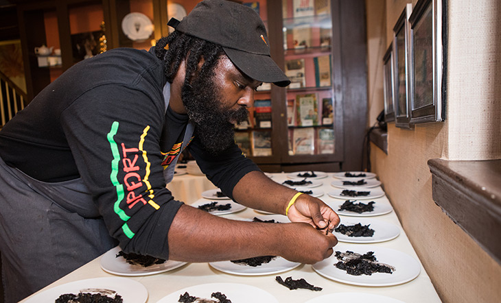 Omar Tate plates a dish at the Beard House photo by Clay Williams