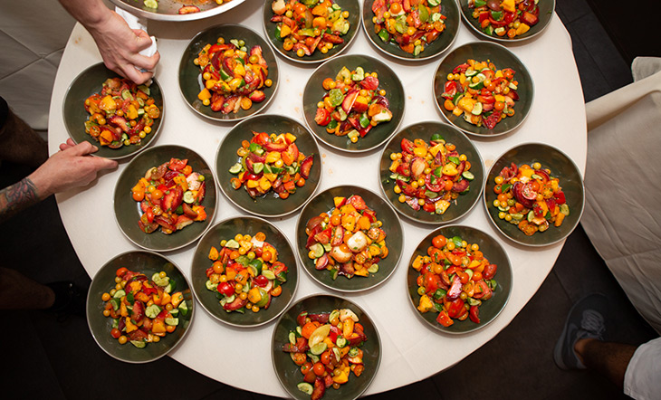 Plating tomato salad at the Beard House photo by Clay Williams