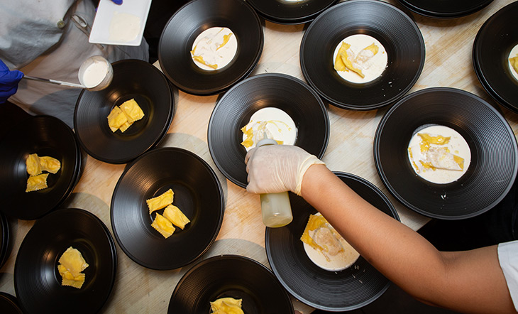 Hands plating food photo Clay Williams