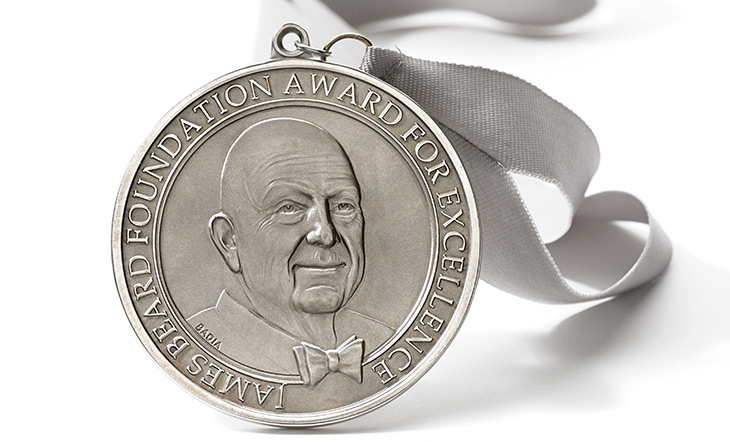 James Beard Awards medallion with a grey ribbon on a white background