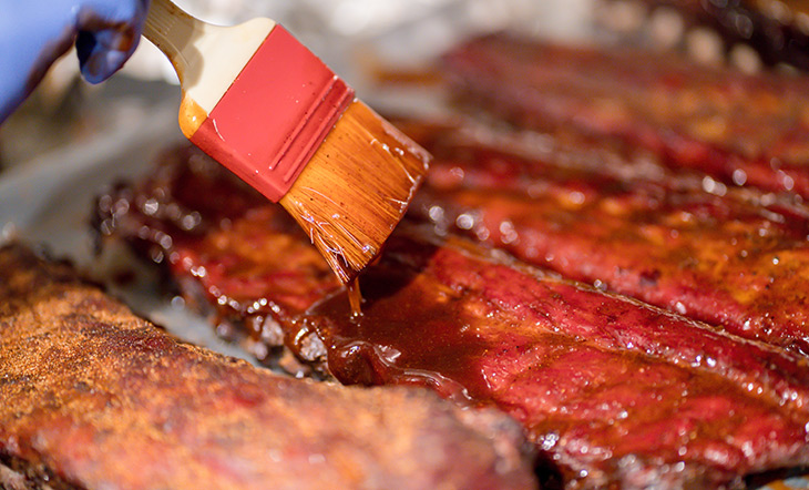 Pork ribs being glazed photo by Eric Vitale