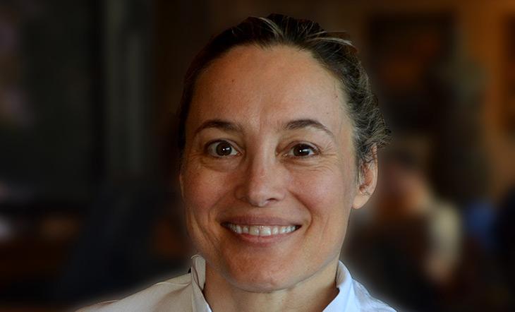 Sarah Stegner in chef whites headshot photo by Cindy Kurman