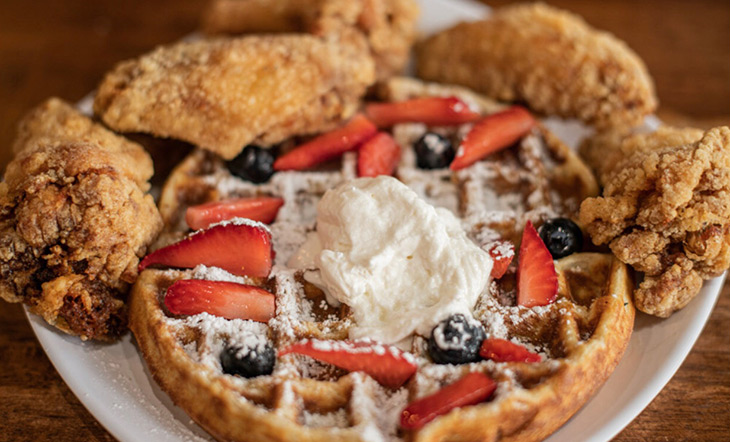 Chicken and Waffles with fresh fruit and whipped cream from Yo' Mama's Restaurant in Birmingham, Alabama photo by Tan Crowder Photography