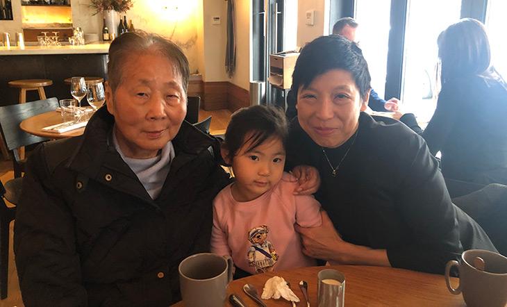 Ellen Yin's mother, Ellen Yin's niece, and Ellen Yin seated at a table, photo by Ellen Yin